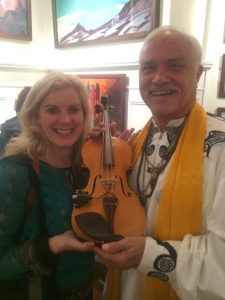 Nell Rose Foreman and Patrick McCollum with the World Peace Violin